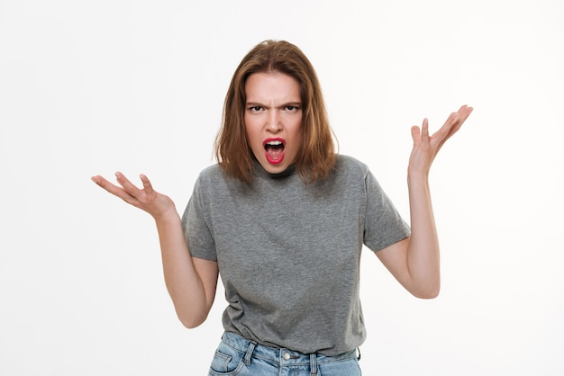 Angry screaming young caucasian lady