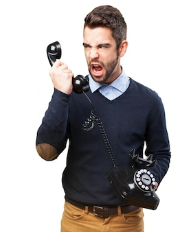 Angry teenager yelling at handset