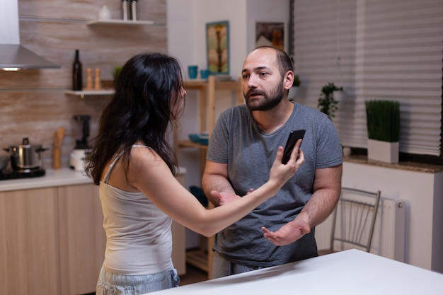 Angry wife and husband in conflict because of cheating