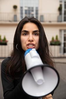 Angry woman holding megaphone medium shot