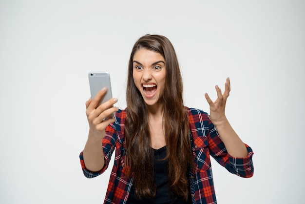 Angry woman shout at mobile phone