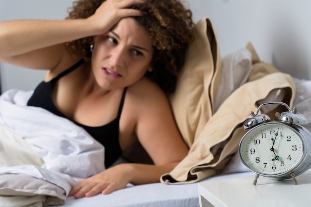 Angry woman with alarm clock