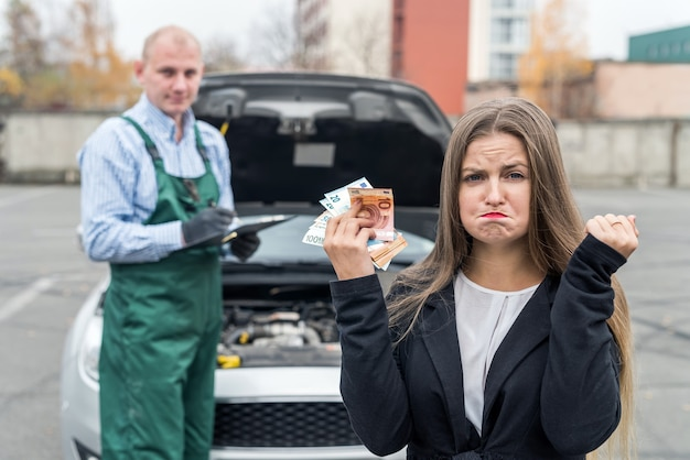 Angry woman with euro going to pay for maintenance