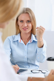 Angry yelling boss point arm to exit dismissing sad worker portrait.
