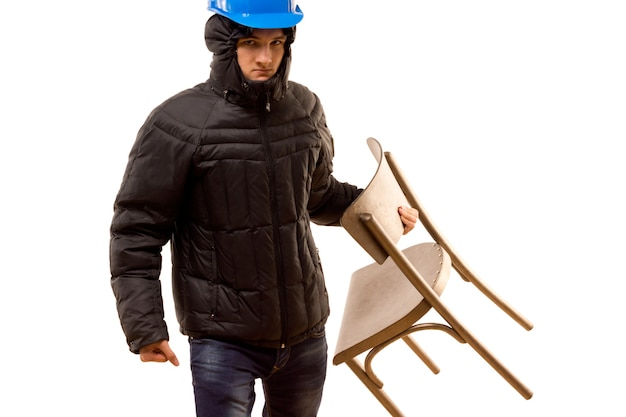 Angry young hooligan carrying a wooden chair