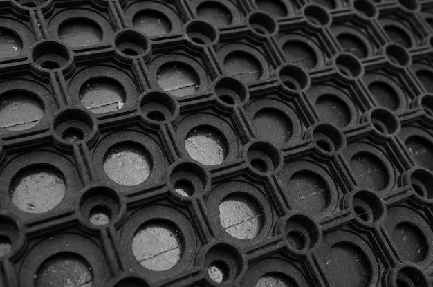 An angular view of a black rubber door mat
