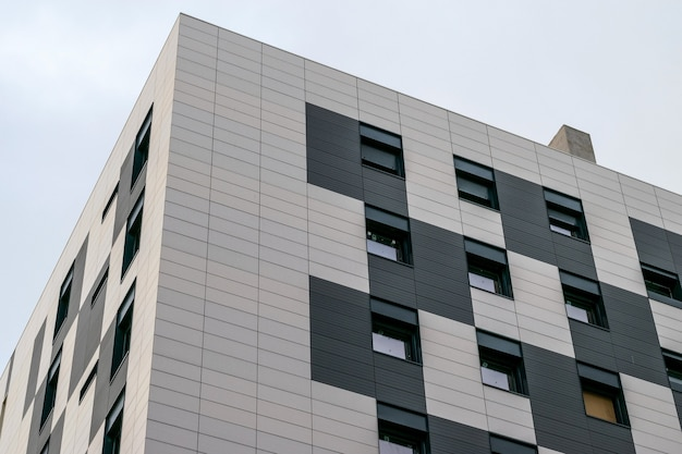 Angular view on a new modern building of apartments. new construction tecnologies concept.