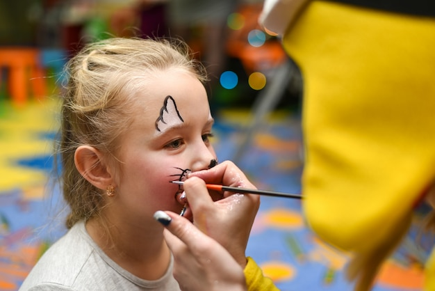 The animator paints the face of the child