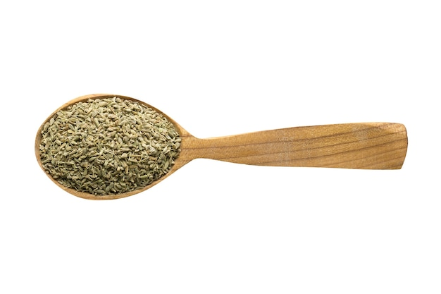 Anise seeds for adding to food. spice in wooden spoon isolated on white. seasoning of delicious meal.