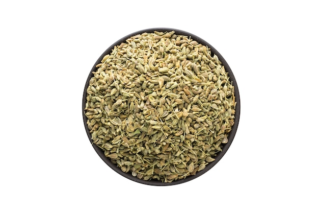 Anise seeds in clay bowl isolated on white background. seasoning or spice top view