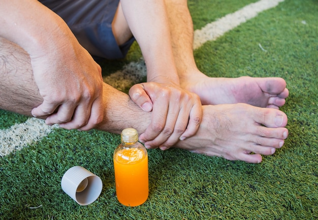 Ankle injury of football player, sports injuries.