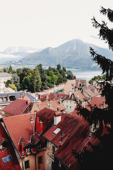 Annecy city top view, lake in the distance. tile roofs, cathedral. high quality photo