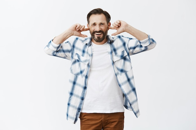 Annoyed bearded mature man posing