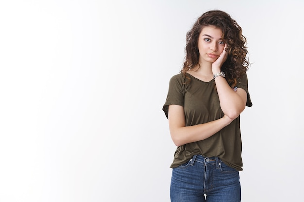 Annoyed fed up attractive tired young woman exhausted hearing boring conversation lean head palm look irritated dying from boredom, look indifferent lack of interest, standing white background