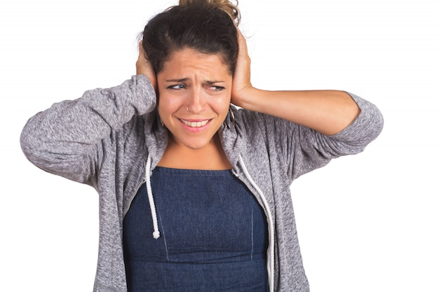 Annoyed and stressed woman covering her ears