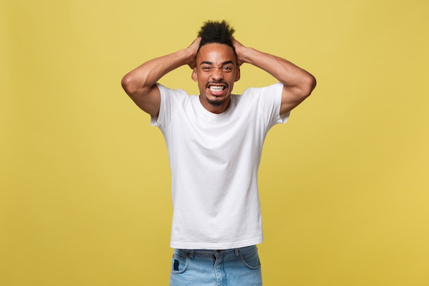 Annoyed young african american man in white shirt with displeased expression