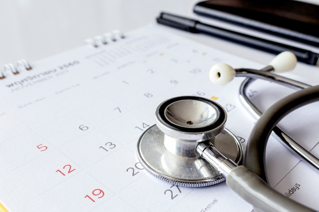 Annual checkup concept. stethoscope on the calendar