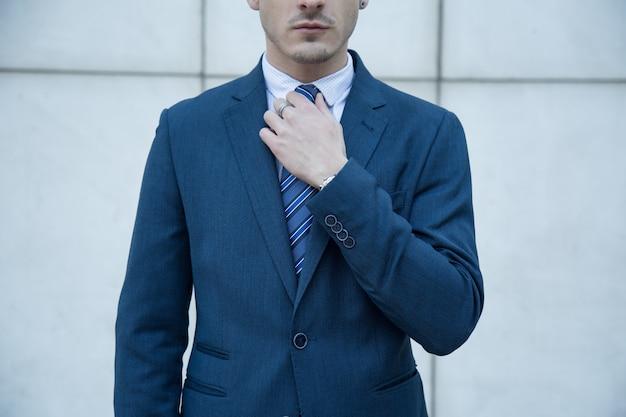 Anonymous businessman on urban scene.