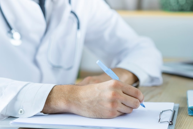 Anonymous doctor making notes