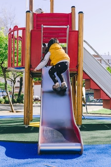 Anonymous girl climbing slide