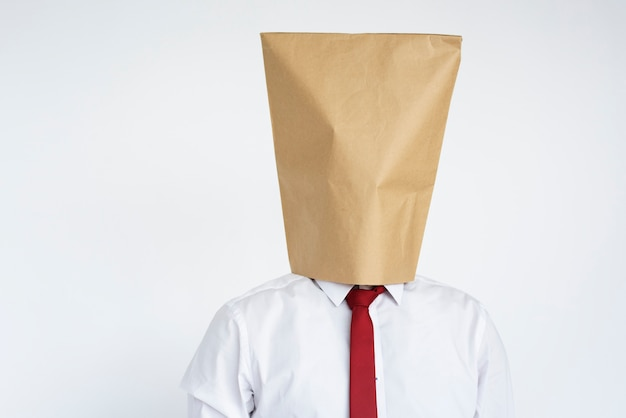 Anonymous man head covered with paper bag