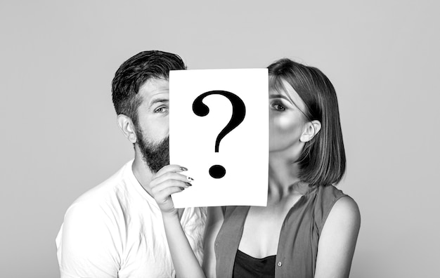 Anonymous, man and woman question. kiss couple, incognita. problems and solutions. couple in quarrel. quarrel between people. problem in couple, question mark. couple holding paper question mark.