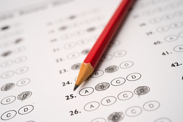 Answer sheets with pencil drawing fill to select choice