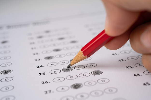 Answer sheets with pencil drawing fill to select choice.