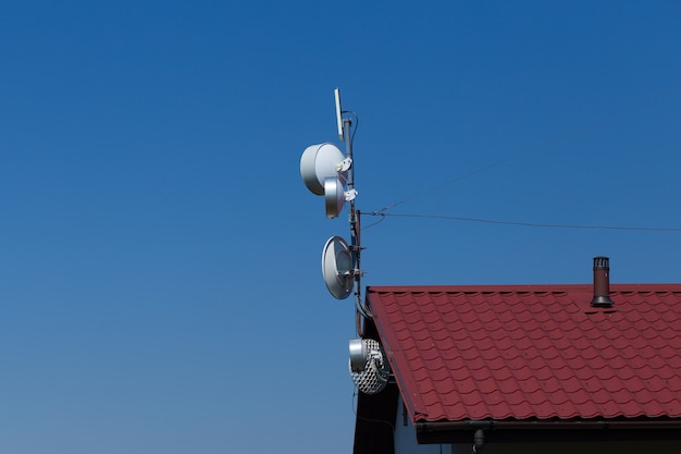 Antenna on the house with blue sky
