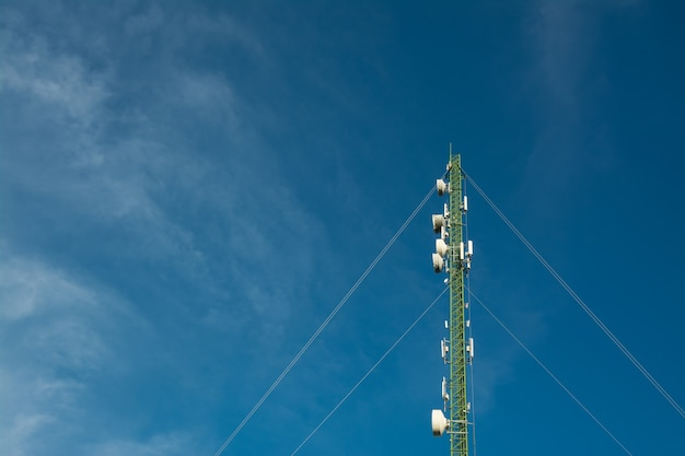 Antenna tower on blue sky background