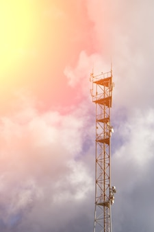 Antenna tower with blue sky and clouds