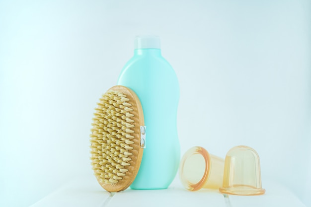 Anti-cellulite products for the prevention and treatment of cellulite and for massageƒ body with a dry wooden brush and vacuum cans