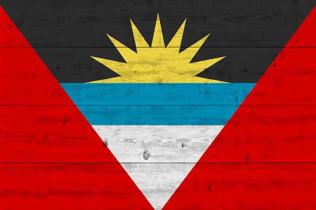 Antigua and barbuda flag painted on old wood plank