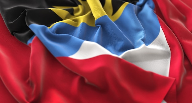 Antigua and barbuda flag ruffled beautifully waving macro close-up shot