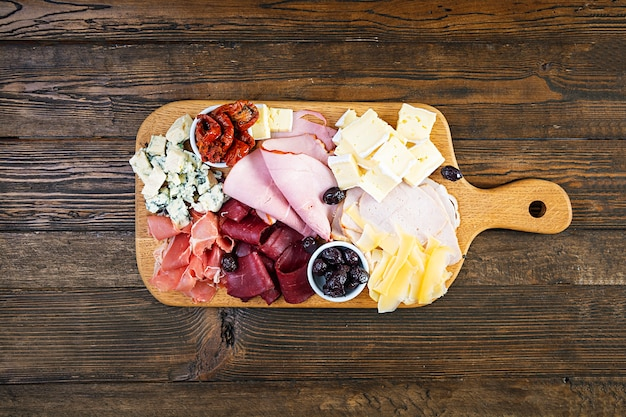 Antipasti board with ham, cheese and olives
