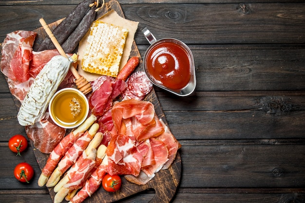 Antipasto background.a variety of meat snacks.