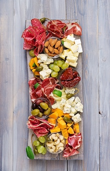 Antipasto catering platter with bacon, jerky, sausage, blue cheese and
