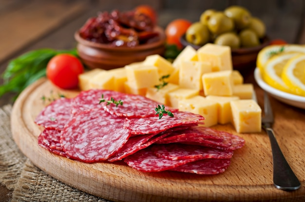 Antipasto catering platter with salami and cheese on a wooden