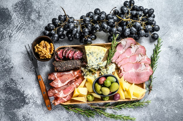Antipasto platter with ham, prosciutto, salami, blue cheese, mozzarella  and olives. top view