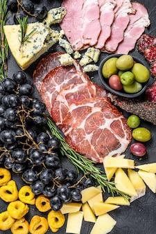 Antipasto platter with ham, prosciutto, salami, blue cheese, mozzarella and olives.