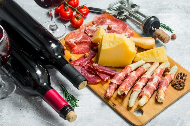 Antipasto. various meat and cheese snacks with red wine. on a rustic.