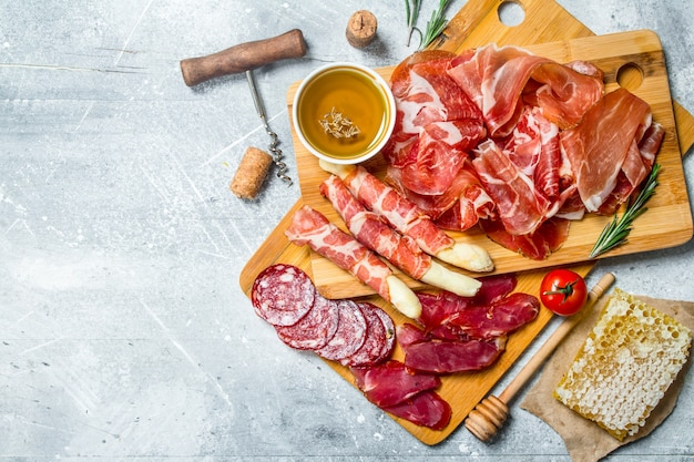 Antipasto.the various meats. on a rustic.