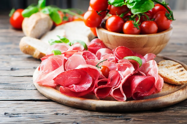 Antipasto with ham and tomatoes