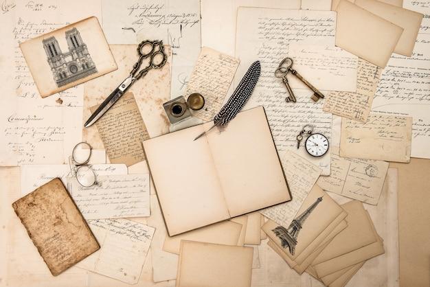 Antique accessories paris postcards old letters and vintage ink pen paper background