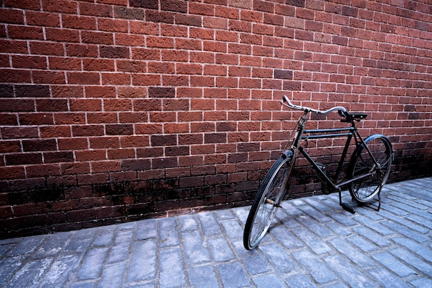 Antique bike with red brick background.  vintage concept