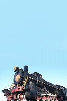 Antique black retro-train on track.