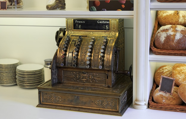 Antique cash register, on a shop window