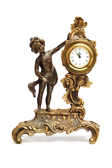 Antique clock with figurine of women isolated on white
