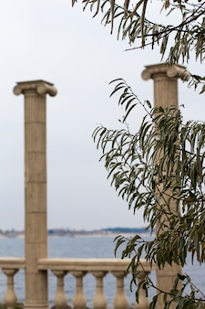 Antique columns by the sea