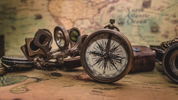 Antique compass on old map